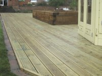 Shifnal decking built around summerhouse
