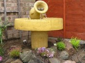 water feature stone jug on pedestal